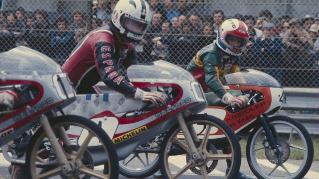 Angel Nieto (Bultaco 50cc #1) and Eugenio Lazzarini (Kreidler 50cc #4), on the start line for the 1977 Italian 50cc Grand Prix.